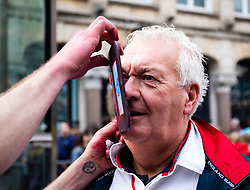 An England fan having faceprint applied<br /> <br /> Photographer Simon King/Replay Images<br /> <br /> Six Nations Round 3 - Wales v England - Saturday 23rd February 2019 - Principality Stadium - Cardiff<br /> <br /> World Copyright © Replay Images . All rights reserved. info@replayimages.co.uk - http://replayimages.co.uk