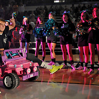 C.J. Gettys of the UNCW men's basketball team arrives on a pink jeep at Friday night's midnite madness at Trask Coliseum.  Mike Spencer/StarNews