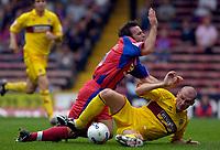 Photo: Daniel Hambury.<br />Crystal Palace v Burnley. Coca Cola Championship. 26/08/2006.<br />Palace's Dougie Freedman is tackled by Burnley's John McGreal.