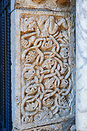 12th century medieval relief sculptures on the doors of the Basilica Church of Santa Maria Maggiore, Tuscania .<br /> <br /> Visit our ITALY PHOTO COLLECTION for more   photos of Italy to download or buy as prints https://funkystock.photoshelter.com/gallery-collection/2b-Pictures-Images-of-Italy-Photos-of-Italian-Historic-Landmark-Sites/C0000qxA2zGFjd_k .<br /> <br /> Visit our MEDIEVAL PHOTO COLLECTIONS for more   photos  to download or buy as prints https://funkystock.photoshelter.com/gallery-collection/Medieval-Middle-Ages-Historic-Places-Arcaeological-Sites-Pictures-Images-of/C0000B5ZA54_WD0s