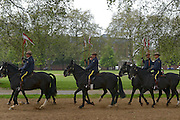 © Licensed to London News Pictures. 22/05/2012. London, UK The mounties train in a sunny Hyde Park. Canadian Mounties rehearse with members of The Household Cavalry today 22 May 2012 to Guard Her Majesty the Queen at Horse Guards Parade. They will guard on Wednesday 23 May and will be the first non-British force to guard the Queen ever. Photo credit : Stephen Simpson/LNP