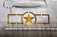 The Xo Viet Nghe Tinh Museum is a small museum detailing the struggles of the Vietnamese revolutionary movement during the French occupation. Metallic piece of a plane with a yellow star painted on it. Vinh, Vietnam, Asia