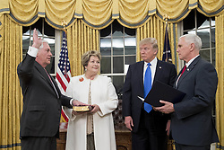 February 1, 2017 - Washington, District of Columbia, U.S. - US President DONALD J. TRUMP (2-R) watches as REX TILLERSON (L) is sworn-in as Secretary of State by US Vice President MIKE PENCE (R), beside Tillerson's wife RENDA ST. CLAIR (2-L), in the Oval Office of the White House. Tillerson was confirmed by the Senate in a 56-to-43 vote to become the nation's 69th Secretary of State. (Credit Image: © Michael Reynolds/Pool/CNP via ZUMA Wire)