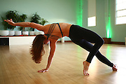 Female Yoga instructor in her studio Model release Available