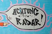 Achtung Radar, Graffiti on a wall in an underpass. Photographed on the Inn River cycling path, Tyrol, Austria