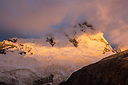 Golden light of sunset hits Nevado Santa Cruz Norte (5829 m or 19,120 ft). This was day 8 and camp 8 of 10 days trekking around Alpamayo in Huascaran National Park (UNESCO World Heritage Site), Cordillera Blanca, Andes Mountains, Peru, South America.