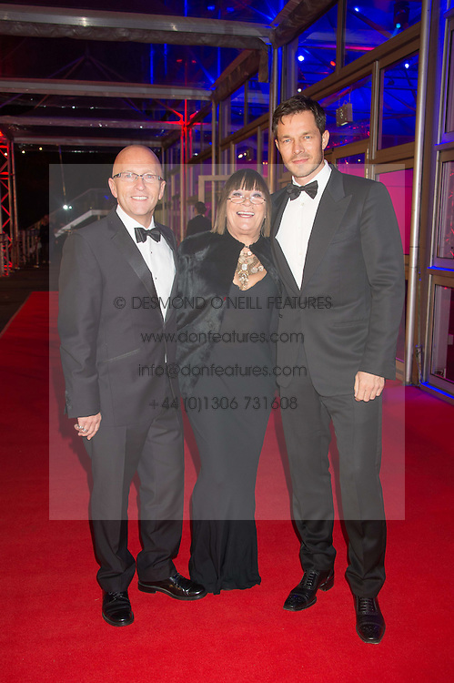 Left to right, NICKY JOHNSTON, HILARY ALEXANDER and PAUL SCULFOR at the Battersea Dogs & Cats Home's Collars & Coats Gala Ball held at Battersea Evolution, Battersea Park, London on 12th November 2015.