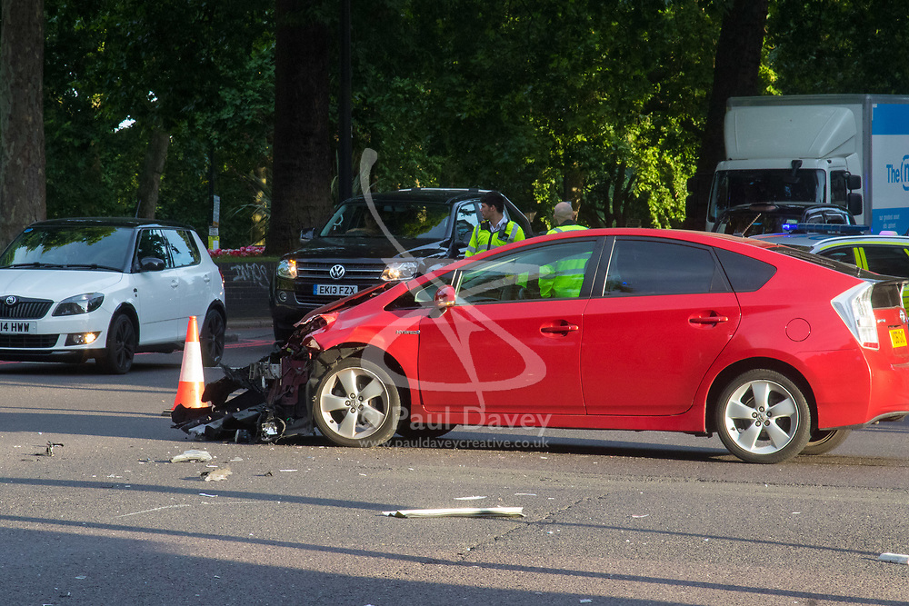 London, July 7th 2017. Emergency services attend a collision between a red Toyota Prius and an ambulance on Park Lane at the intersection of Upper Grosvenor Street. There are no reported injuries, but the ambulance was carrying a patient at the time of the collision, which has closed down all but one southbound lane on Park Lane, with surrounding streets closed to traffic. Pictured: The Toyota Prius.