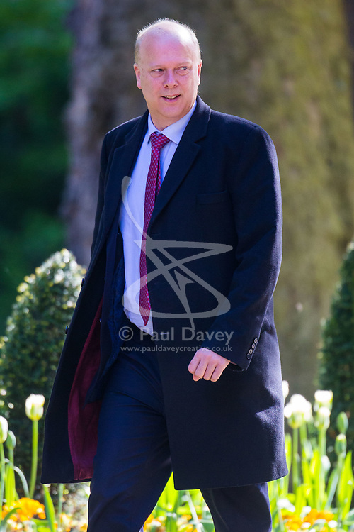 Transport Secretary Chris Grayling arrives at 10 Downing Street to attend the weekly cabinet meeting.