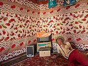 Dilshod listening to music. In Roshorv village.