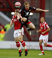 Photo: Steve Bond/Richard Lane Photography. Nottingham Forest v Doncaster Rovers. Coca Cola Championship. 28/11/2009. james Coppinger (R) and Paul McKenna (L) in the air