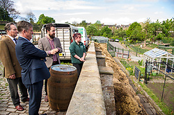 Pictured: George Elliis, Keith Brown, Josiah Lockhart and  Maia Gordon<br /> <br /> Cabinet Secretary for Economy, Jobs & Fair Work Keith Brown visited Gorgie City Farm today  to mark their accreditation as the 800th Living Wage employer in Scotland. Mr Brown met Josiah Lockhart, CEO and undertook a short tour of the farm, celebrating their accreditation and promoting the Living Wage more generally. The Scottish Government has set a target of reaching 1,000 Scottish-based Living Wage Accredited Employers by autumn 2017. While at the farm Mr Brown met Maia Gordon, Kirsty McGoff (17) and Zoe White (18), who have benefited from the living wage, and George Ellis, chair of the farm's board of directors<br /> Ger Harley   EEm 18 May 2017