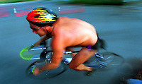 Randy Cotton of Coral Gables heads around a turn near the Vinoy hotel in a blur as he competes in the bike portion of the three leg event of the St. Anthoneys Triathalon, 04/24/94.