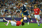 Wembley, Great Britain, USA., Striker,  ALEX MORGAN, jumps over Saki KUMAGAI as she heads towards the Japanese goal during the USA Women's Football Team 2-1 win over Japan to win the Gold Medal at the 2012 London Olympic , Women's Football, Gold Medal Match at Wembley Stadium, USA vs Japan, 21:00:55  Thursday  09/08/2012 [Mandatory Credit: Peter Spurrier/Intersport Images]