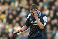 Photo: Paul Thomas.<br />Bolton Wanderers v Manchester City. The Barclays Premiership. 21/01/2006.<br />Man City's Richard Dunne leaves the field to get treatment after banging heads with Stelios.