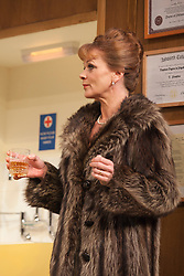 © Licensed to London News Pictures. 09/05/2012. London, England. Samantha Bond as Mrs Prentice. What the Butler Saw by Joe Orton and directed by Sean Foley opens at the Vaudeville Theatre, London. Photo credit: Bettina Strenske/LNP