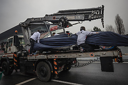 March 1, 2018 - Barcelona, Catalonia, Spain - The Haas VF-18 of Kevin Magnussen is braught back to the pit stop at day four of Formula One testing at Circuit de Catalunya. (Credit Image: © Matthias Oesterle via ZUMA Wire)