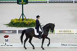 Sergey Buikevich, (KAZ), Ispovednik - Grand Prix Team Competition Dressage - Alltech FEI World Equestrian Games™ 2014 - Normandy, France.<br /> © Hippo Foto Team - Leanjo de Koster<br /> 25/06/14