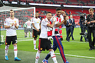 Jesse Lingard of Manchester United and Marcus Rashford of Manchester United celebrate winning the FA Cup during the The FA Cup Final between Crystal Palace and Manchester United at Wembley Stadium, London, England on 21 May 2016. Photo by Phil Duncan.