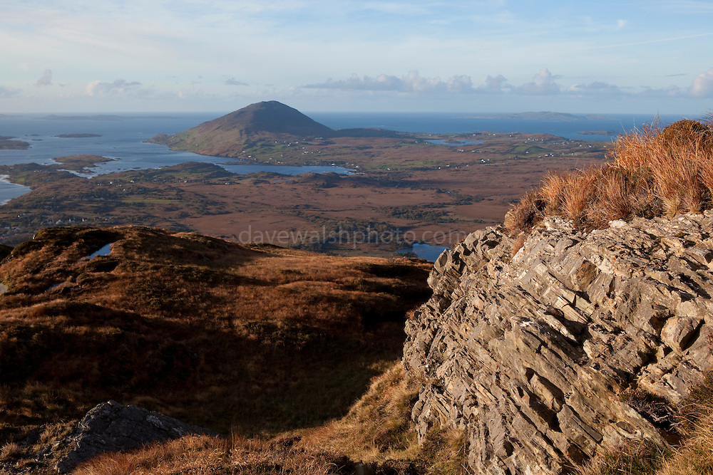 The view of Ballinakill Bay and the Connemara coast, including Tully Mountain, seen from Diamond Hill, a mountain in the Twelve Bens (or Pins) range, part of Connemara National Park, Galway, Ireland