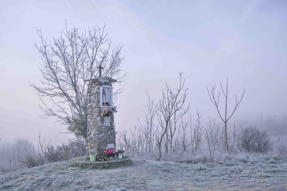A typical little shrine (alminhas) covered with frost from a cold winter morning in Trás-Os-Montes.