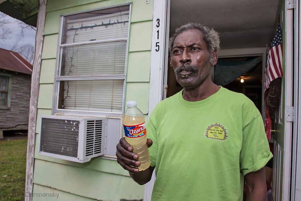 Eddie Sanders holds a bottle he filled at home to show the poor condition of his tap water. Gov. John Bell Edwards made an emergency health proclamation on December 16, 2016, enabling a fast-tracked replacement of St. Joseph's water system after lead was found in the water.