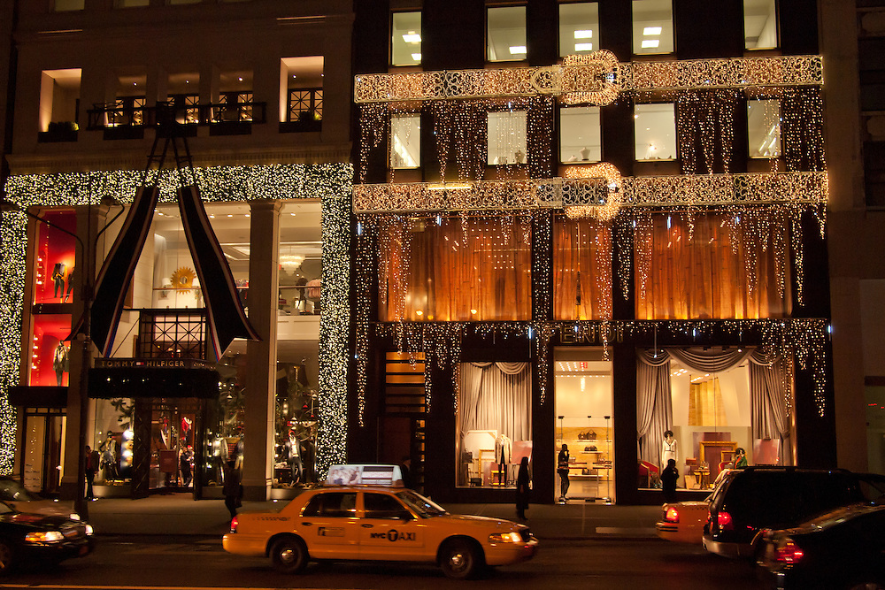 The Tommy Hlfiger store on the left and it's neighbor the Fendi store on Fifth Avenue are festooned with holiday lights at Christmas time.