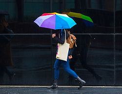 London, January 02 2018. A woman's umbrella gives a splash of colour on a dull, wet day in London as rain descends on the capital . © SWNS