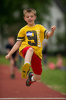 Brady Teixeira of Woodland Heights gets good air for his long jump during the 5th grade track meet with Elm Street, Pleasant Street and Woodland Heights Elementary Schools Wednesday morning at Opechee Park.  (Karen Bobotas/for the Laconia Daily Sun)