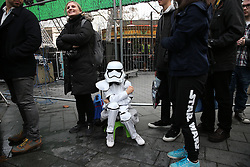 © Licensed to London News Pictures. 16/12/2015. London, UK. A boy waits in line dessed as a Stormtrooper in Leicester Square ahead of the UK premiere of Star Wars: The Force Awakens. Photo credit: Peter Macdiarmid/LNP