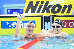 HANGZHOU, Dec. 12, 2018  Katinka Hosszu (L) of Hungary celebrates after Women's 200m Butterfly Final at 14th FINA World Swimming Championships (25m) in Hangzhou, east China's Zhejiang Province, on Dec. 12, 2018. Katinka Hosszu claimed the title with 2 minutes 1.60 seconds. (Credit Image: © Xinhua via ZUMA Wire)