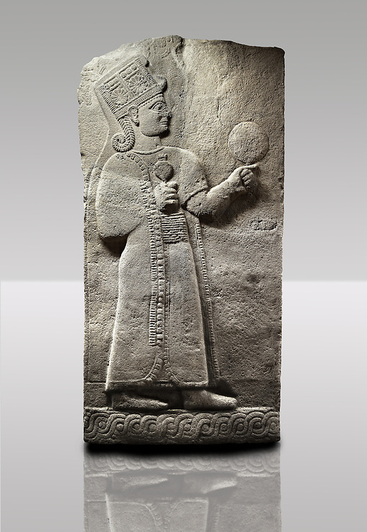 Picture & image of a Neo-Hittite orthostat showing a releif sculpture  of the Goddess Kubaba from Karkamis,, Turkey. Museum of Anatolian Civilisations, Ankara. 4 In her right hand she is holding a pomegranate