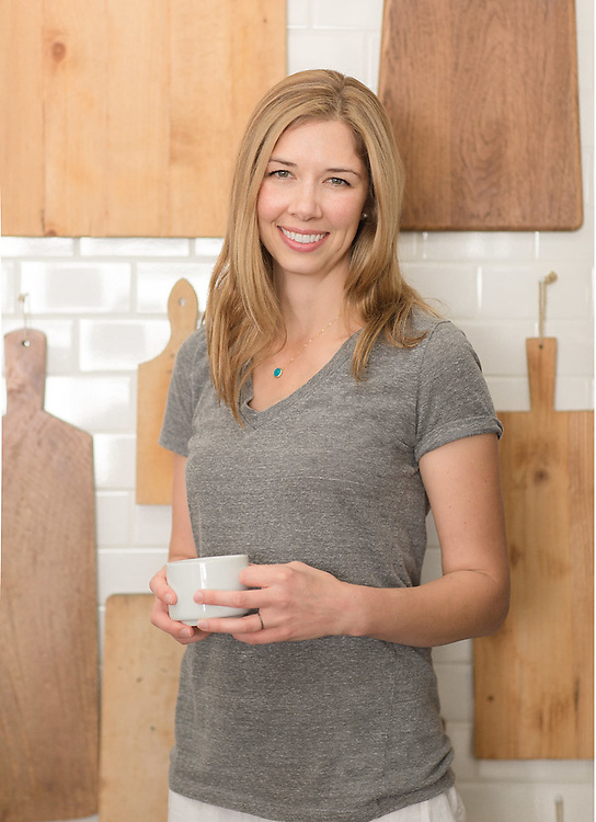 Women relax in kitchen with a cup of coffee