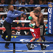 LAS VEGAS, NV - SEPTEMBER 13: Referee Kenny Bayless steps in to break apart Floyd Mayweather Jr. (R) and Marcos Maidana during their WBC/WBA welterweight title fight at the MGM Grand Garden Arena on September 13, 2014 in Las Vegas, Nevada. (Photo by Alex Menendez/Getty Images) *** Local Caption *** Floyd Mayweather Jr; Marcos Maidana; Kenny Bayless