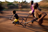 Children play outside the Boma Hospital in South Sudan.