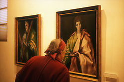 El Greco museum; Toledo; with visitor looking at paintings,