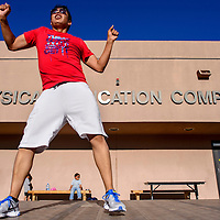 082814       Cable Hoover<br /> <br /> Zumba instructor Ralph Roanhorse leads a Zumba workout outside the Physical Education Complex at UNM-Gallup Thursday.