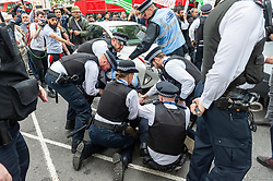 Police detain a man as demonstrators gathered outside India House in London to show support for Kashmiris and to protest against occupation and oppression by India in Kashmir. <br /> <br /> Richard Hancox | EEm 15082019