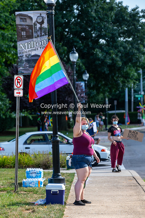 A demonstrator waves a pride flag during the Milton Pride Rally. The I Am Alliance organized the event after an area grocery store posted an anti-mask sign which blamed the LGBTQ community for spreading COVID-19.