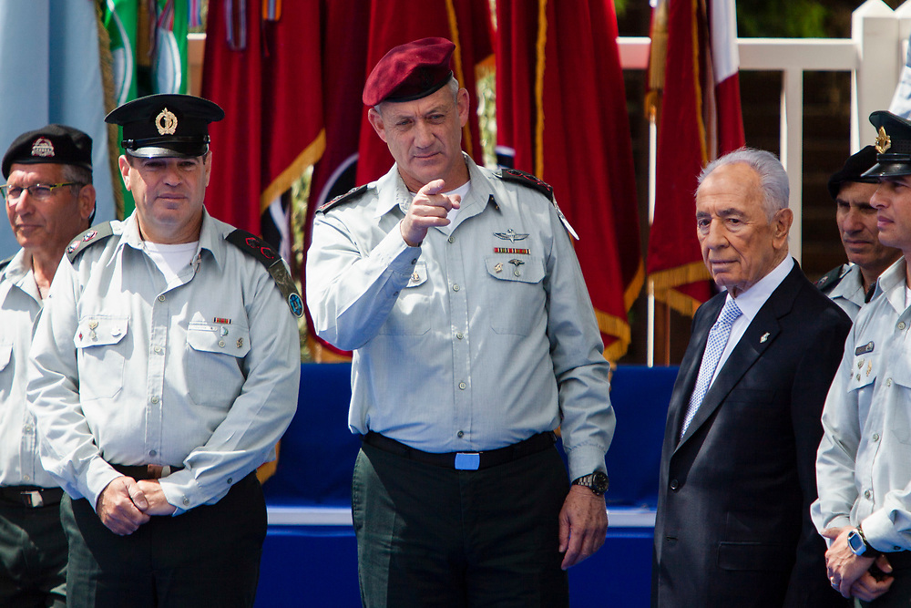 Israeli Chief of Staff, Lieutenant-General Benny Gantz (C) and Israel's President Shimon Peres (2nd R) attend Israel's Independence Day celebration at the Israeli President's Residence in Jerusalem, on April 16, 2013, as the Jewish state celebrates its 65th Independence Day.