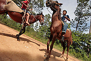 Brothers Michael Barna, 8, and Davide Daniel Barna, 12, play with their horses on a dirt road in Alemanha, Honduras.  Honduras is considered the third poorest country in the Western Hemisphere (Haiti, Nicaragua). With over 50% of the population living below the poverty line and 28% unemployed, Hondurans frequently turn to illegal immigration as a solution to their desperate situation. The Department of Homeland Security has noted an 95% increase in illegal immigrants coming from Honduras between 2000 and 2009, the largest increase of any country.