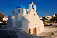 Blue domed white Byzantine Greek Orthodox Chapel of Panaghia Gremiotissa. Chora  (Hora), Ios, Cyclades Islands, Greece. .<br /> <br /> Visit our GREEK HISTORIC PLACES PHOTO COLLECTIONS for more photos to download or buy as wall art prints https://funkystock.photoshelter.com/gallery-collection/Pictures-Images-of-Greece-Photos-of-Greek-Historic-Landmark-Sites/C0000w6e8OkknEb8