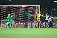 Norwich City midfielder Jacob Murphy (22) shoots at goal during the EFL Sky Bet Championship match between Brentford and Norwich City at Griffin Park, London, England on 31 December 2016. Photo by Matthew Redman.