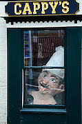 A giant chef's head peers out from the window of Cappy's Bakery in Camden, Maine.