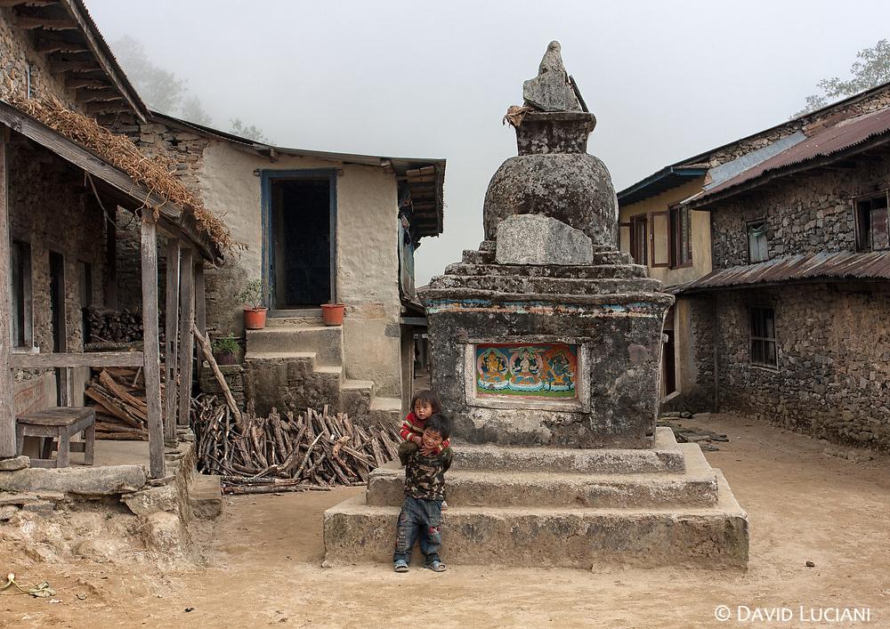 Two kids playing near the stupa of Golphu Bhanjyang.