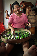For Balinese women, creating offerings for home as well as village temples is part of the daily routine and plays significant part in their lives.