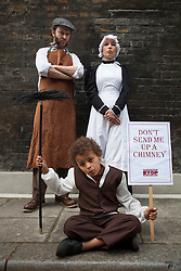 © licensed to London News Pictures. London, UK 31/05/2012. Jude Chinchen (centre), Gemma Turmelty (right) and Stephen Russell (left) posing as Victorian workers as TUC launches employment rights campaign today in London (31/05/12). Photo credit: Tolga Akmen/LNP