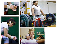 Weightlifter and Olympic hopeful Melanie Roach lifts the weights to her shoulders while doing a clean and jerk of 108 kilograms during a training session in Auburn, Wash. on Saturday, May 3, 2008. (AP Photo/John Froschauer).