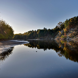 The sun shines on the Merrimack River in Canterbury, New Hampshire.