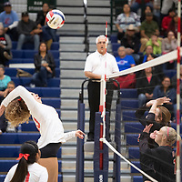 Pine Hill's Maurie Daniels (13) goes up for a spike in their match against Tatum Thursday evening at Rio Rancho High School in the NMAA Class 1A State Volleyball tournament in Rio Rancho.